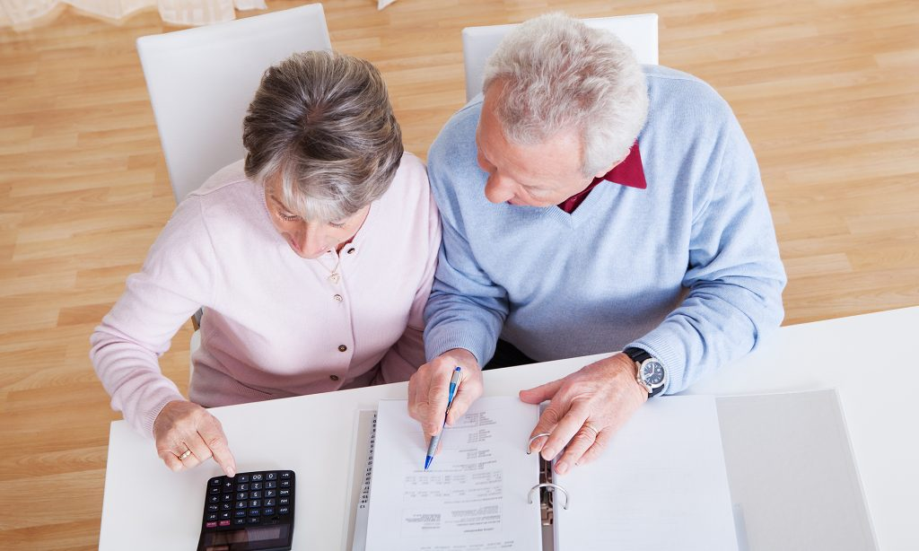 elderly couple going over finances