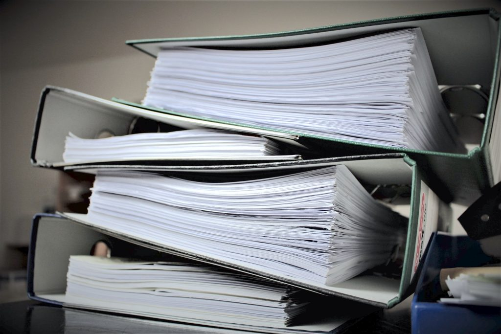 stack of binders filled with papers